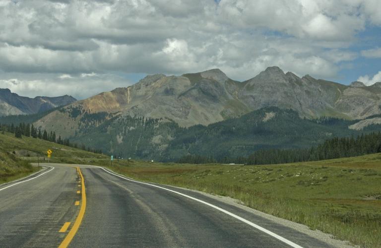 colorado road highway trip drive vacation travel rico mountain co rain clouds