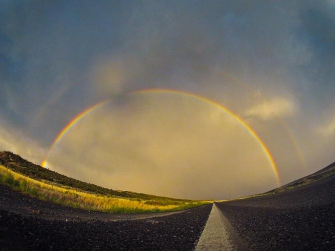 road rainbow highway prairie vast open range wyoming montana