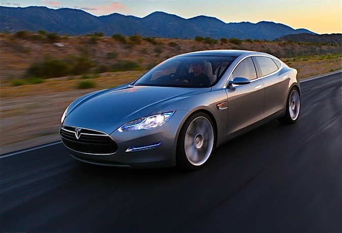 Tesla Model S electric vehicle driving long distance in the desert