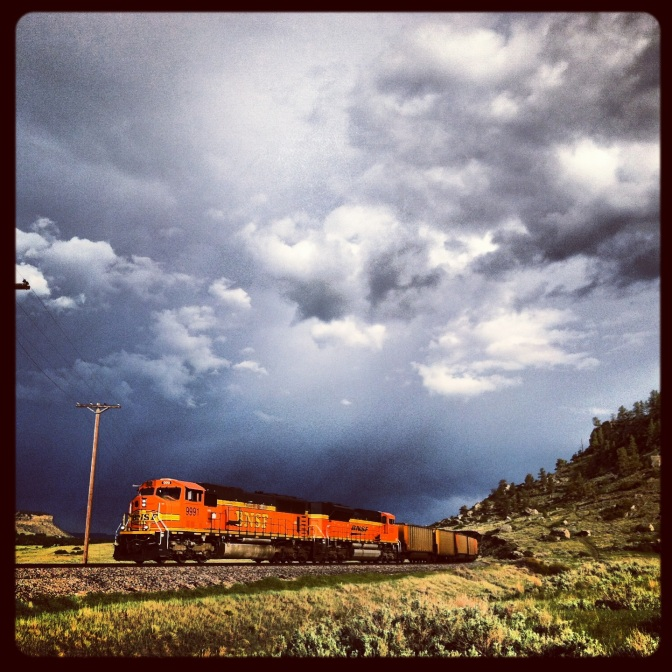 Train under Storm Clouds