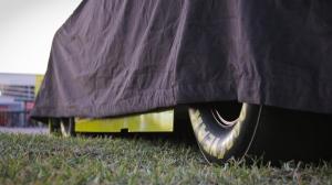 NASCAR race car under wraps at Daytona, travel